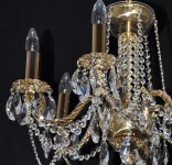 Detail of the 6 Arms Crystal cast brass chandelier with glossy twisted arms