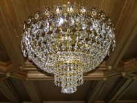 Surface-mounted basket crystal chandelier with crystal stones on wooden ceiling