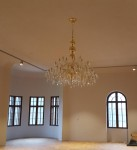 Large golden crystal chandelier in the interior of Bojnice castle Slovakia