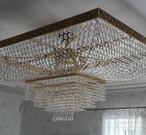 Rectangular crystal chandelier with strass stones in residential interior