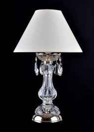 Glass lamp on the bedside table in the bedroom with lampshade - silver metal