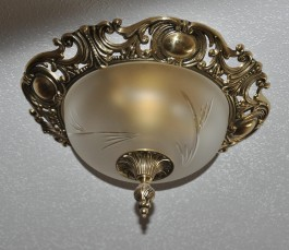 Luxurious surface-mounted luminaire reminiscent of antique chandeliers made of solid cast brass