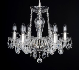 Small crystal chandelier chandelier on the ceiling of the bedroom