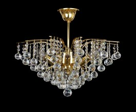 Golden crystal chandelier in the shape of a royal crown