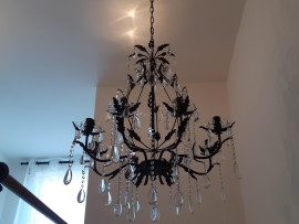 The brown crystal chandelier in the color of a stair railing