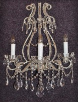 The 3-arms crystal wall light with cut pearls