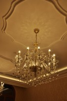 Luxury crystal chandelier in the old stone building