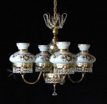 The 4 arms crystal chandelier with milk glass schirms