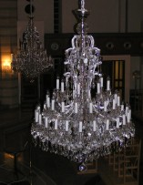 Detail of an extinguished silver chandelier of Maria Theresa 48 light bulbs