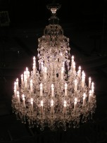 A large Terezin chandelier is lit.