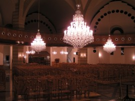 View of the hanging Theresian chandeliers in the interior of the church Tseri