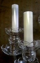 The milk glass tubes covering electrical sockets