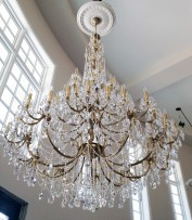 The 65 large cats brass chandelier in interior