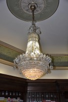 Antique chandelier washing - Fragner's pharmacy Prague