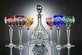 Set of colored hand cut wine glasses and the crystal carafe