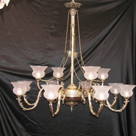 The large cast brass chandelier with sand-blasted vases
