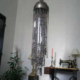Chandelier in the shape of a glass tube filled with crystal trimmings (smoky glass)