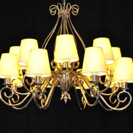 The custom-made silver tubular chandelier with the lampshades in cream color