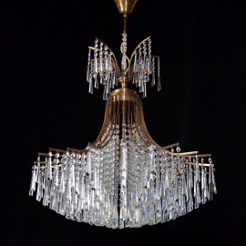 The design chandelier with cut crystal hooves - brown stained brass ANTIK