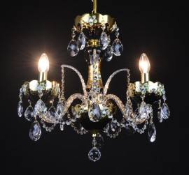 Lit small black crystal chandelier with flowers