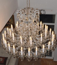 Installation of a large 36-flames Theresian chandelier with adjustable height