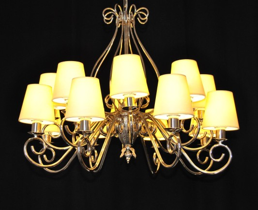 The custom-made silver tubular chandelier with yellow 12 lampshades