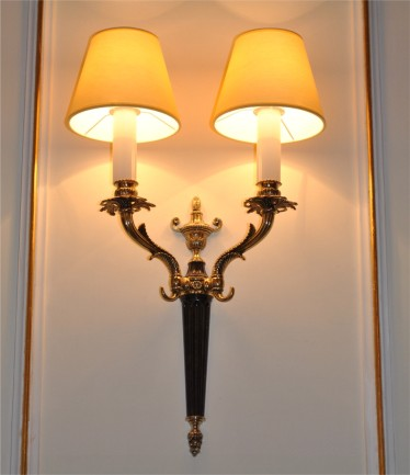 The cast brass wall light with 2 lampshades & violet painting