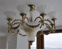 Cast brass chandelier with masssive sand-blasted glass parts