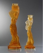 Candlesticks made of orange glass (Amber)